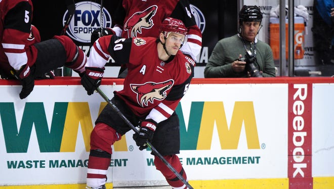 Mar 17, 2016: Arizona Coyotes center Antoine Vermette (50) looks to pass during the second period against the San Jose Sharks at Gila River Arena.