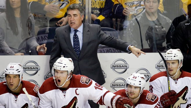 Arizona Coyotes head coach Dave Tippett protests a call in the second period of an NHL hockey game against the Nashville Predators Tuesday, Oct. 21, 2014, in Nashville, Tenn.