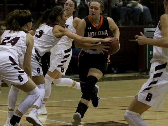 Nocona's Averee Kleinhans drives to the basket in the