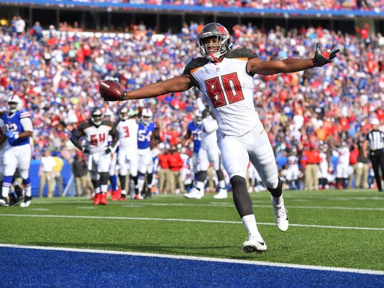 Tampa Bay Buccaneers tight end O.J. Howard (80) scores a touchdown during the second half of an NFL football game against the Buffalo Bills Sunday, Oct. 22, 2017, in Orchard Park, N.Y. (AP Photo/Rich Barnes)