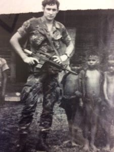 Former Asheville City Councilman and current Buncombe County GOP Chairman Carl Mumpower did serve in Vietnam during the war. In this picture, Mumpower stands in front of Vietnamese children in a place called Duc Co.