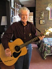 Nelson has a collection of musical instruments; guitars,