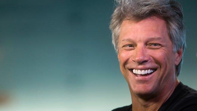 Musician Jon Bon Jovi laughs during media interviews in Vancouver, British Columbia, Saturday, Aug. 22, 2015.