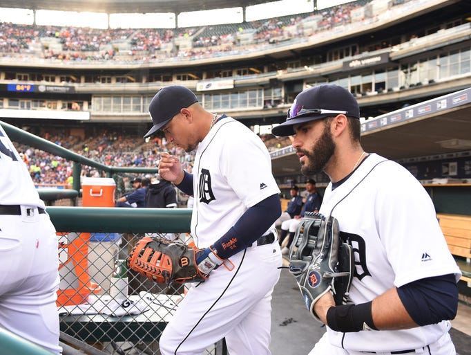 Tigers' Miguel Cabrera, left, and J.D. Martinez head