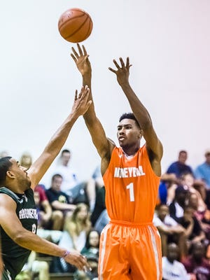 Javon Bess, right, shoots over Drew Valentine during their Moneyball Pro-Am game July 1, 2014 in Lansing.