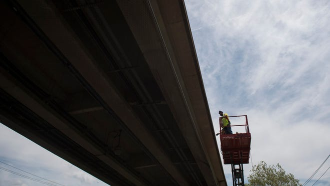 Subcontractors with Railroad Construction work on installing steel handrails at the Westmont Station in Haddon Township.
