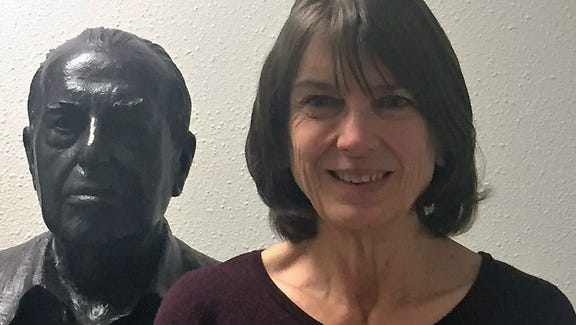 Lisa Pugh pictured with a bust of artist Tom Lea.