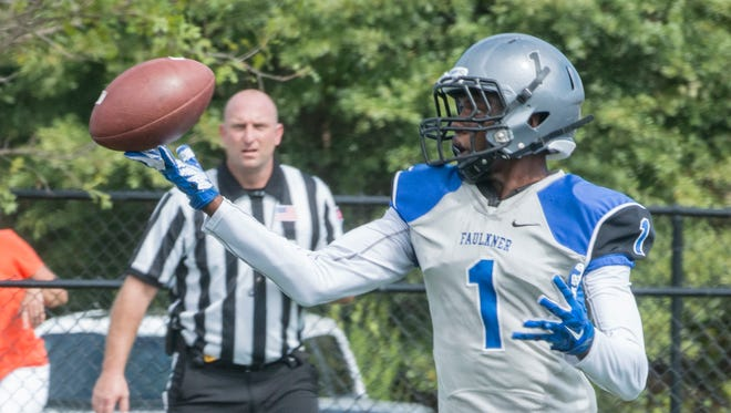Faulkner wide receiver Rob Lockhart gets his fingertips on a bobbled reception before running it in for a touchdown. Faulkner University shut out Georgetown College at home on Saturday, Sept. 26, 2015, in Montgomery. Faulkner won 44-0.