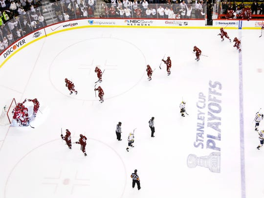The Coyotes celebrate after winning their series against