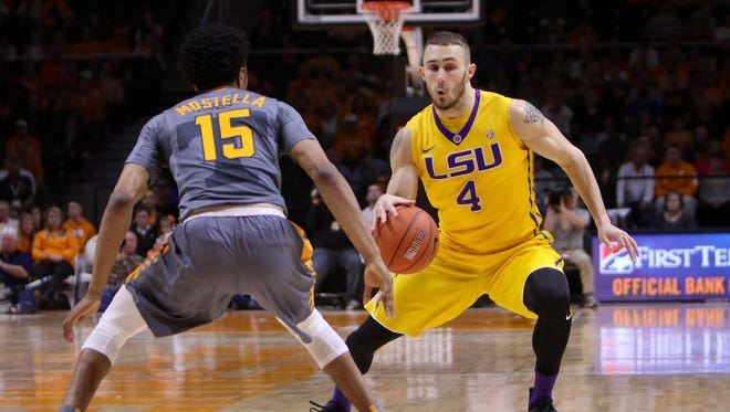 LSU Tigers guard Keith Hornsby (4) dribbles the ball as Tennessee Volunteers guard Detrick Mostella (15) defends at Thompson-Boling Arena.