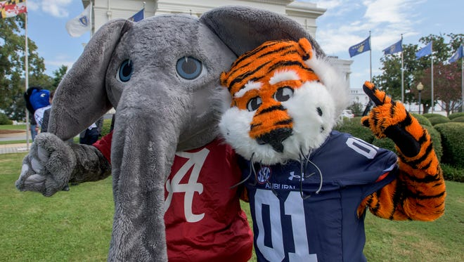Big Al and Aubie get together as mascots from the state's universities and colleges promote College Colors Day at the State Capitol Building in Montgomery, Ala., on Friday August 26, 2016. College Colors Day is Friday September 2, 2016.