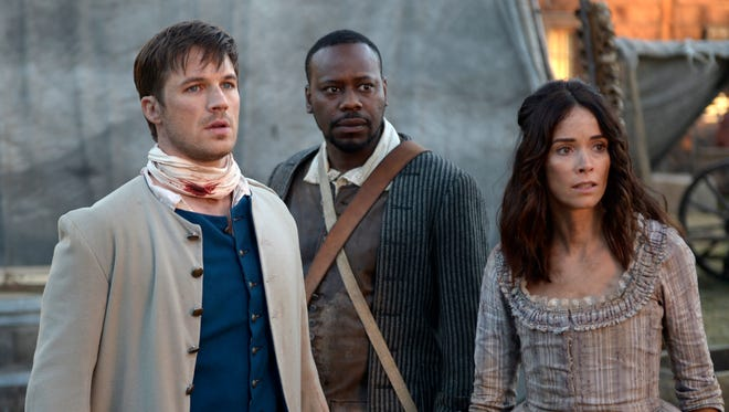 Matt Lanter as Wyatt Logan, Malcolm Barrett as Rufus Carlin and Abigail Spencer as Lucy Preston travel to the past in NBC's 'Timeless,' whose cancellation was reversed by NBC, citing fan support.