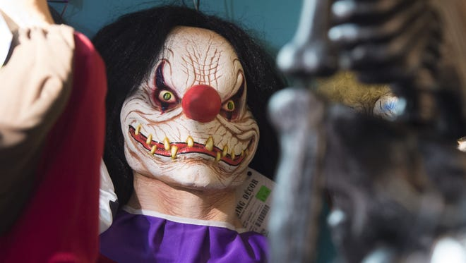 """Halloween costumes and props, including a """"scary"""" clown mask, are seen for sale at a party store in Arlington, Va., Oct. 7, 2016."""