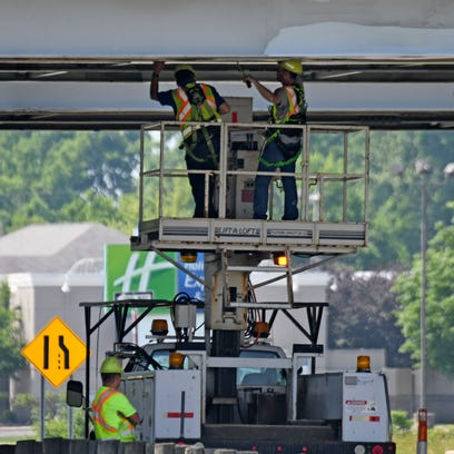 ODOT workers stay cool in the shade as they do maintenance