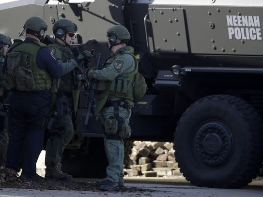 Officers respond to the 2015 armed standoff at Eagle Nation Cycles in Neenah.