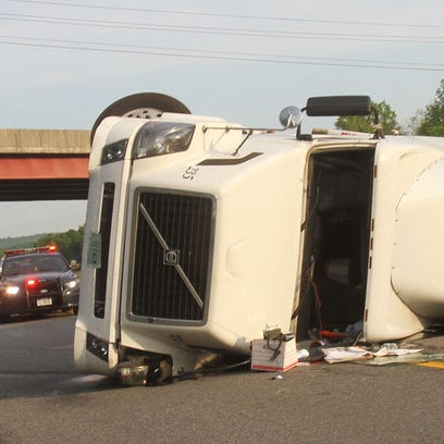 A tractor-trailer rolled over on eastbound Interstate