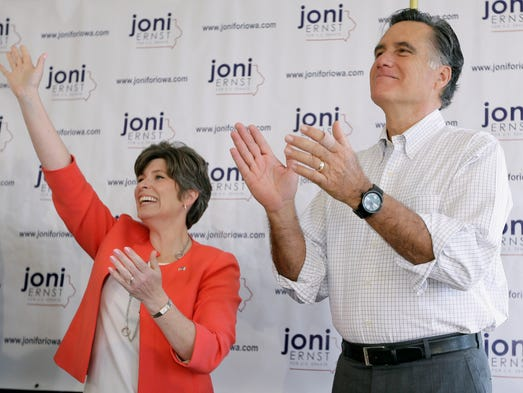 Former Republican presidential nominee Mitt Romney greets supporters before speaking at a rally for Iowa Republican Senate candidate Joni Ernst, left, Friday, May 30, 2014, in Cedar Rapids.