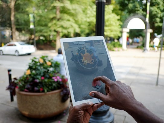 John Jackson catches a Raticate on his tablet in Market