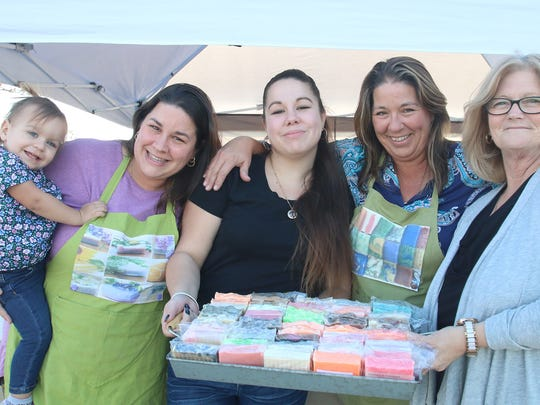 Isabella and Shannon Prezioso, Jordan Griffin and Dawn Mayer of Your Body Bliss display a few of the soaps donated to Stacy Malinowski of Mustard Seed Ministries.