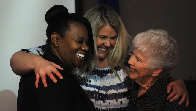 Traci Davis, left, celebrates with board members Lisa Ruggerio, middle, and Barbara McLaury moments after the board voted to hire her as superintendent during a special Washoe County School District board meeting in Reno on Friday afternoon, July 10, 2015. Davis has been serving as interim superintendent for the past year.