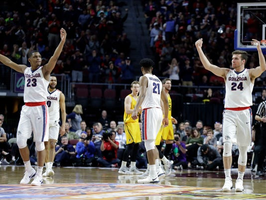 Gonzaga's Zach Norvell Jr. (23) and Corey Kispert (24) react after scoring during the first half of a West Coast Conference tournament NCAA college basketball game against San Francisco Monday, March 5, 2018, in Las Vegas. (AP Photo/Isaac Brekken)