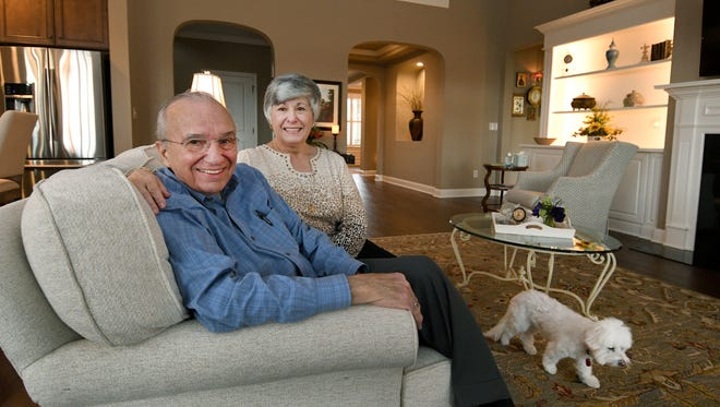 Harry and Vicki Moskos and dog Daisy in their Farragut home Jan. 10, 2017.