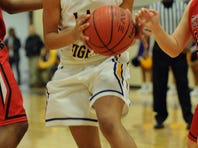 Hattiesburg's Jazmin Boyd (13) shoots the ball against Petal Friday during their game in Hattiesburg.