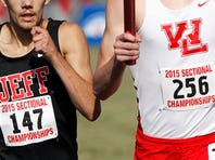 Cooper Williams of West Lafayette on the final lap of the 4 X 800 meter relay is marked by Cayce Griffin of Lafayette Jeff during the boys track sectional Thursday, May 2015, at the West Lafayette athletic complex. West Lafayette won the event with sectional record time of 8:01.75.