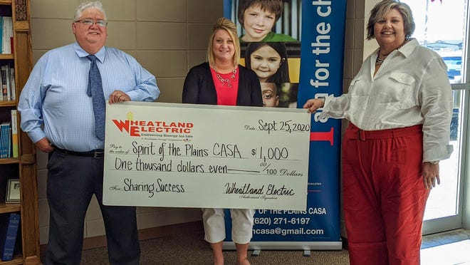 Spirit of the Plains, CASA, Inc., accepts a $1,000 grant from Wheatland Electric's Sharing Success Funds. Pictured from left: Robert DeLeon, executive director, Ginger Gallardo, volunteer supervisor, and Debbie Reynolds, volunteer coordinator. The funds will benefit recruitment of new volunteers in Scott County.