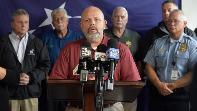 CEMA Director Dennis Jones speaks at a press conference alongside other public officials during preparations last year for Hurricane Dorian.