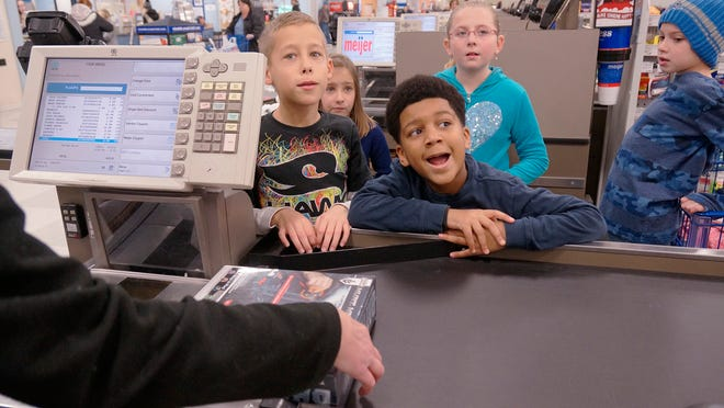 Brendan Borsh (from left), Madison Borsh, Titus Quinn, Chloe Scarpace and Isaac Denis watch the total bill for toys grow.