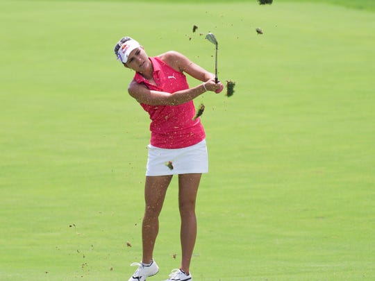 "A ""racer-back"" top like Lexi Thompson often wears is permitted under new LPGA dress code rules. Why? Because it has a collar ."