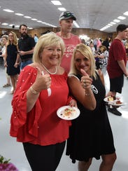 Taste of the Twin Lakes attendees shoot the camera