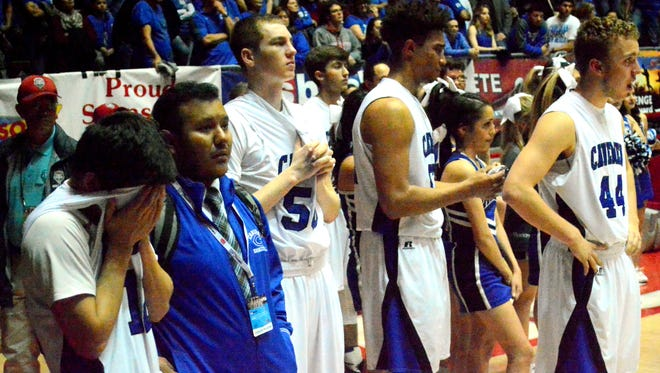 Reality sets in as Carlsbad watches Rio Rancho hoist this year's U.S. Bank 6A state tournment championship trophy Saturday at The Pit.