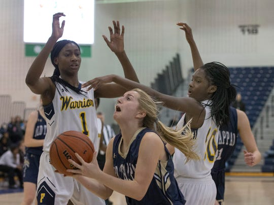 NV/Old Tappan's Jackie Kelly breaks through to the basket for a second half shot. NV/Old Tappan vs Franklin Girls Basketball in NJSIAA quarterfinal game at Toms River on March 14, 2018