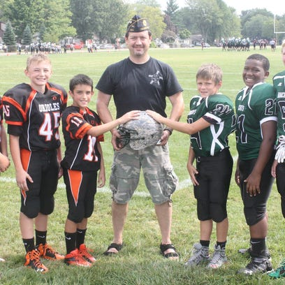 Michigan Military Moms founder Gary Tanner (center)