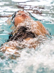 Gabrielle Brust swimming for the Pataskala Porpoises swims the backstroke in the medley relay at the Tri-County Aquatic League Championship swim meet at Denison University.