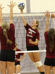 NMSU sophomore outside hitter Brigette Lowe spikes a ball during practice.