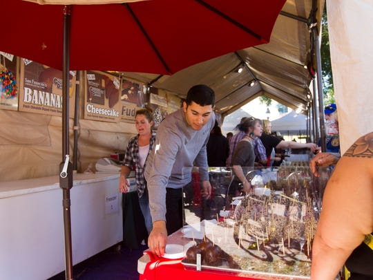 Chocolate-covered apples and other treats are served