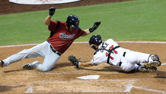 Mitch Delfino of the Sacramento River Cats avoids the tag from El Paso Chihuahuas catcher Rocky Gale before reaching to touch home plate for a run in the bottom of the fifth inning Wednesday at Southwest University Park.