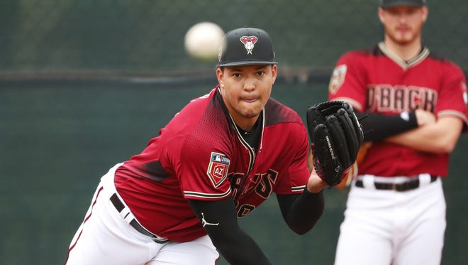 Arizona Diamondbacks starting pitcher Taijuan Walker (99) throws during the first day of workouts for pitchers and catchers at Salt River Fields on the Salt River Pima-Maricopa Indian Reservation February 14, 2018.