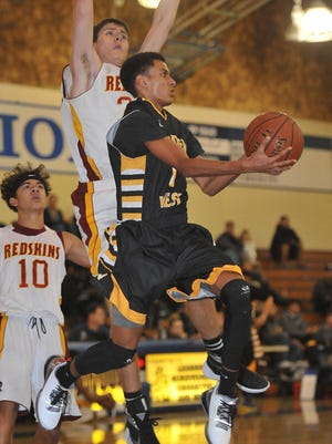 Golden West junior Abel Abraham attempts a shot against Tulare Union during a first round game at the Polly Wilhelmsen Invitational on Monday at Redwood High School.