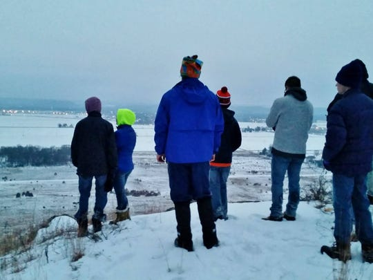 Students from UW-Platteville and members of FLOW took a winter hike at Spring Green Preserve on Sunday, Feb. 8, 2015.