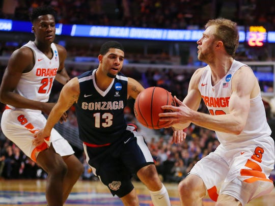 Syracuse guard Trevor Cooney (10) looks to shoot against Gonzaga during the semifinal game in the Midwest regional of the NCAA Tournament at United Center.