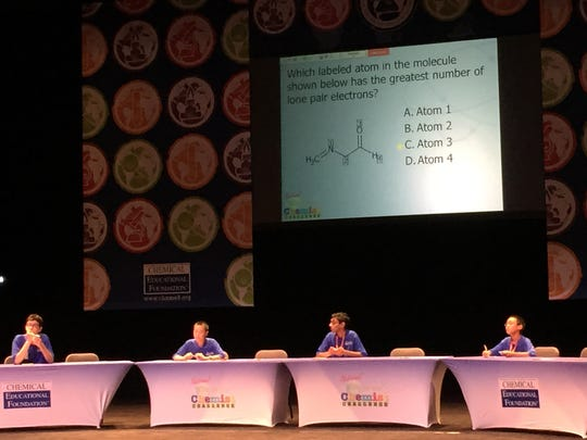 Four middle-school students compete in a sudden-death round of questions to make it into the finals at a chemistry competition Monday in Philadelphia.
