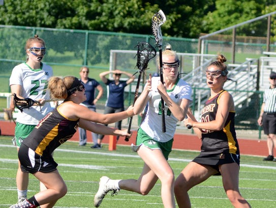 Cranbrook's Jessica Geiger (white jersey) takes on