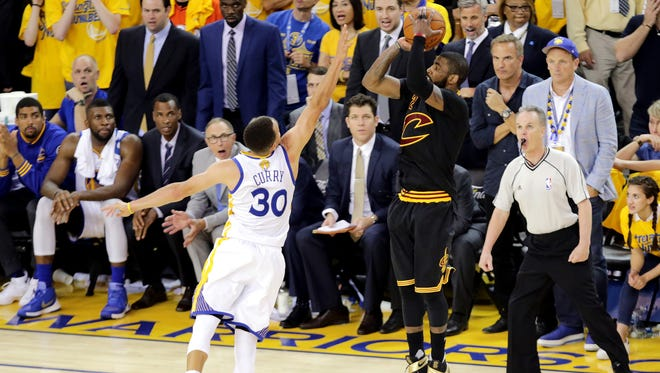 Irving hits the winning shot over Steph Curry.