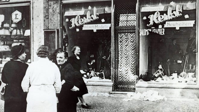 A group of people stand outside a Jewish-owned shop in an unnamed German town in November 1938, after the Kristallnacht, when Nazis thugs burned and plundered hundreds of Jewish homes, shops and synagogues across the country.