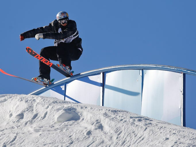 Nick Goepper slides along a rail during the slope style freestyle skiing final at the Dew Tour iON Mountain Championships, Sunday, Dec. 15, 2013, in Breckenridge, Colo. Goepper took first place in the event. (AP Photo/Julie Jacobson)