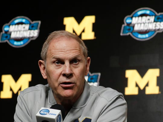 FILE - In this March 27, 2019 file photo Michigan head coach John Beilein speaks during a news conference at the NCAA college basketball tournament in Anaheim, Calif. Two people familiar with the decision say Beilein has agreed to become head coach of the Cleveland Cavaliers. The people spoke to The Associated Press on Monday, May 13, 2019 on condition of anonymity because the team had not announced the hire. ESPN, citing unidentified sources, said Beilein agreed to a five-year deal with the Cavaliers. (AP Photo/Chris Carlson, file)